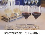 side by side red white wine in... | Shutterstock . vector #711268870