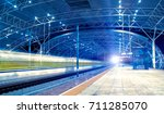 the high speed train raced past ... | Shutterstock . vector #711285070