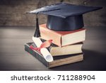 graduation hat and diploma with ...   Shutterstock . vector #711288904