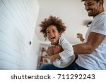 shot of african american father ... | Shutterstock . vector #711292243
