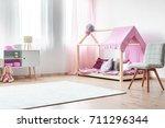 charming girl's bedroom with...   Shutterstock . vector #711296344