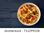 penne pasta with meatballs in... | Shutterstock . vector #711299218