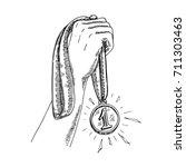 holding gold medal  hand of the ... | Shutterstock .eps vector #711303463