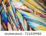 colorful microscopic shot of sugar micro crystals in polarized light