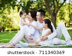young happy asian family... | Shutterstock . vector #711340369
