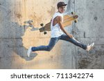 Skater Boy Jumping With...