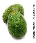 Small photo of Two whole avocado (Persea americana, alligator pear) isolated on white background