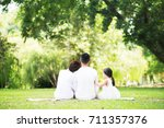 young happy asian family... | Shutterstock . vector #711357376