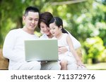 young happy asian family... | Shutterstock . vector #711372976