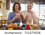 portrait of cheerful young... | Shutterstock . vector #711375028