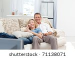 lovers watching tv in the... | Shutterstock . vector #71138071