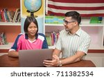 foreign teachers teaching thai... | Shutterstock . vector #711382534