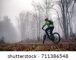 mountain biker riding on trail... | Shutterstock . vector #711386548