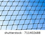 nylon net background   blue sky | Shutterstock . vector #711402688