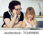 grandma helping kid after... | Shutterstock . vector #711405850