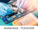 the asian technician pull a... | Shutterstock . vector #711411433