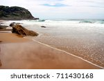 beach on a cloudy day. | Shutterstock . vector #711430168