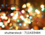 abstract circular bokeh ... | Shutterstock . vector #711435484