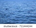 deep blue water sea ocean... | Shutterstock . vector #711444244