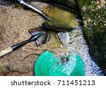 gold panning and gem mining in...   Shutterstock . vector #711451213