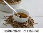 cereal bran sticks and honey in ... | Shutterstock . vector #711458350