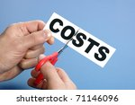 Scissors cutting the word costs concept for recession or credit crisis - stock photo