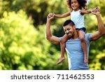 portrait of young father... | Shutterstock . vector #711462553