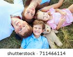happy family lying on grass... | Shutterstock . vector #711466114