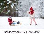 two funny little girls having... | Shutterstock . vector #711490849