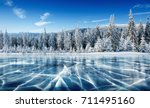 blue ice and cracks on the... | Shutterstock . vector #711495160
