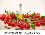 organic tomatoes with basil... | Shutterstock . vector #711531709