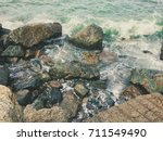 stones in the sea background | Shutterstock . vector #711549490