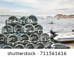 traps for lobsters in the port ... | Shutterstock . vector #711561616