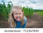 child stuck out tongue summer... | Shutterstock . vector #711567850