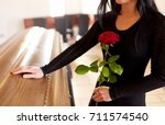 people and mourning concept  ... | Shutterstock . vector #711574540