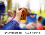 a plastic glass of beer in the... | Shutterstock . vector #711575446