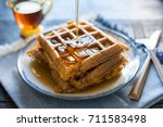 pouring syrup on pumpkin waffles | Shutterstock . vector #711583498