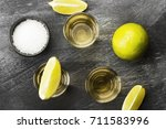 tequila with lime and salt on a ... | Shutterstock . vector #711583996