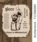 bearded man with a beer mug in... | Shutterstock .eps vector #711586084
