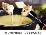 gourmet swiss fondue dinner on...   Shutterstock . vector #711592168