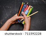colorful pencils in hand... | Shutterstock . vector #711592228