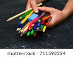 colorful pencils in hand... | Shutterstock . vector #711592234