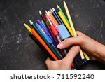 girl holding many colorful... | Shutterstock . vector #711592240