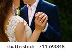 close up. hand of bride and... | Shutterstock . vector #711593848
