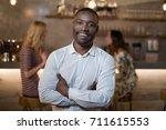 portrait of happy standing with ... | Shutterstock . vector #711615553