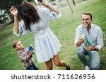 baby boy playing water guns... | Shutterstock . vector #711626956