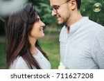 young pretty couple embrace one ... | Shutterstock . vector #711627208