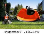 Brush cutter handles with the grass in the court yard - stock photo
