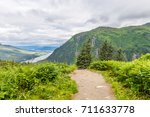 a hiking tail leads down the... | Shutterstock . vector #711633778