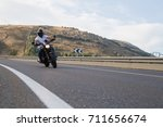 young man riding a motorcycle... | Shutterstock . vector #711656674
